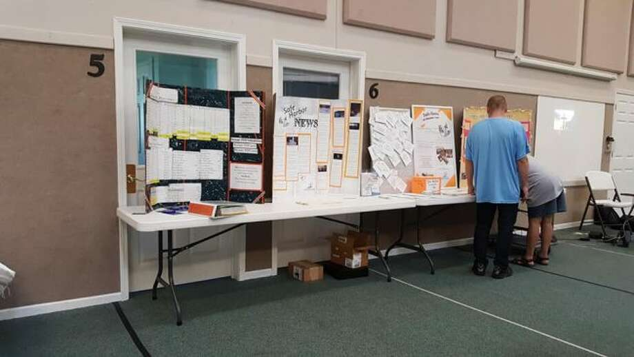 A display of Safe Harbor guest and volunteer stories, news clippings and statistics over the past 10 years is available for viewing in the front entrance of the offices at 525 Michael St. in Manistee. (Courtesy photo)