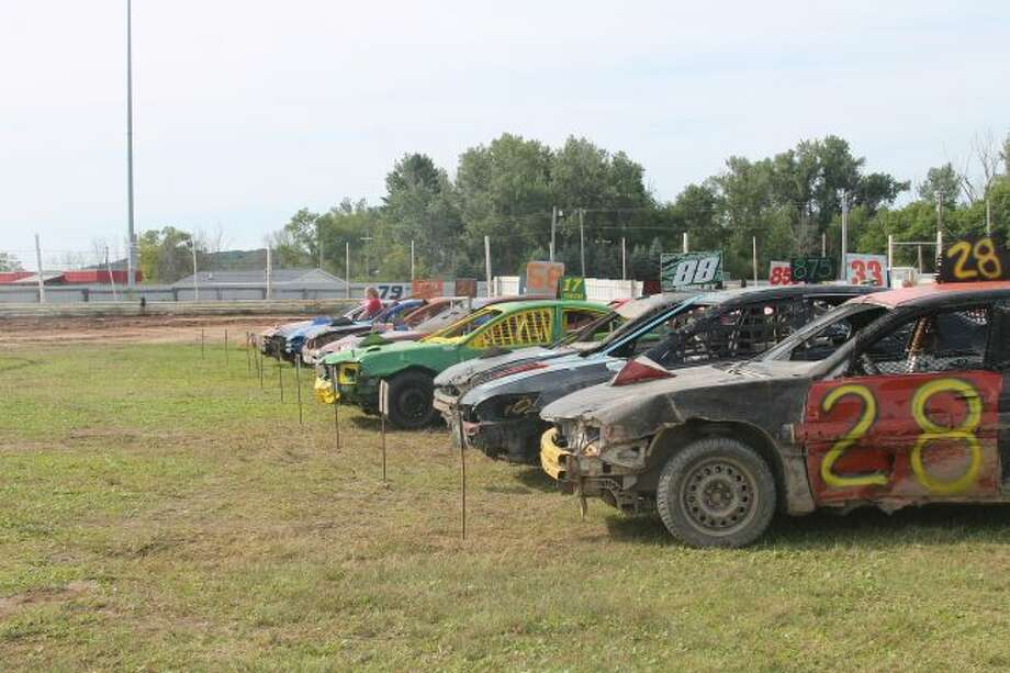 Cars line up in preparation of the T.N.T. Demolition Derby which closed out the grandstand portion of the Manistee County Fair
