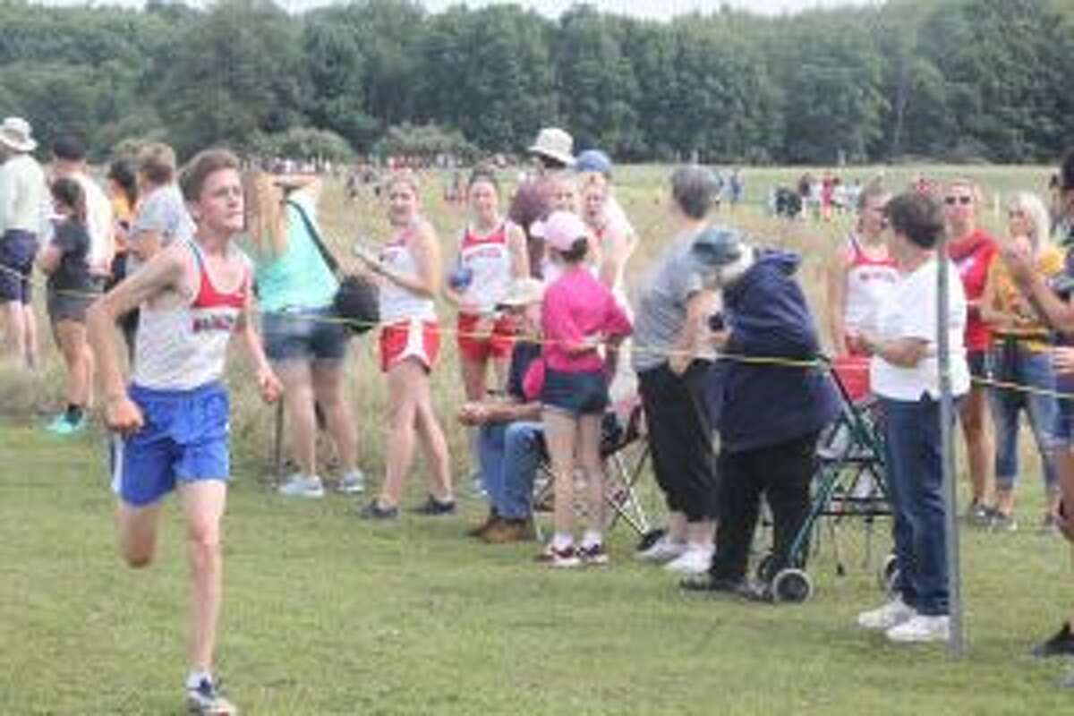 Jake O'Neill finishes his race for Chppewa Hills.