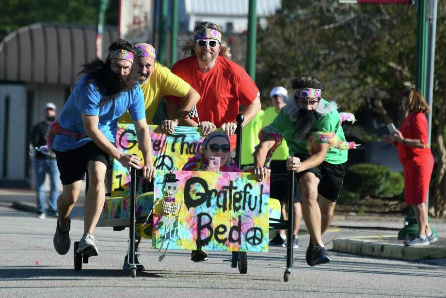 "The Vineyard Church ""Eternally Grateful"" team, of Conroe, including Joseph Laughlin, from left, Brian Simpson, Preston Kolb, Brianna Simpson, and Hawk Nolan, highstep their Grateful Bed to the finish line during the 2018 Bed Races held at Heritage Park in Conroe on Oct. 6, 2018. The team won the ""Best Construction/Design"" award at the event which benefits Family Promise of Montgomery County. Photo: Jerry Baker, Houston Chronicle / Contributor / Houston Chronicle"