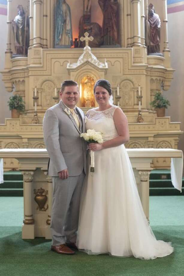 Kylie Bauman and Michael Kepes exchanged vows on June 15 at Guardian Angels Church in Manistee. (Courtesy Photo/LeGalley Photography)