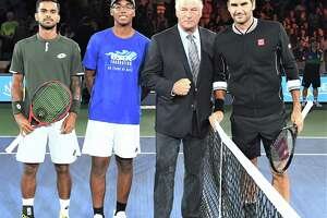 Danbury High School junior Sammy Justo, left centr, with actor Alex Baldwin after tossing the opening coin in Arthur Ashe Stadium on Aug. 26, 2019, before the match between Roger Federer, right, and Sumit Nagal, left.
