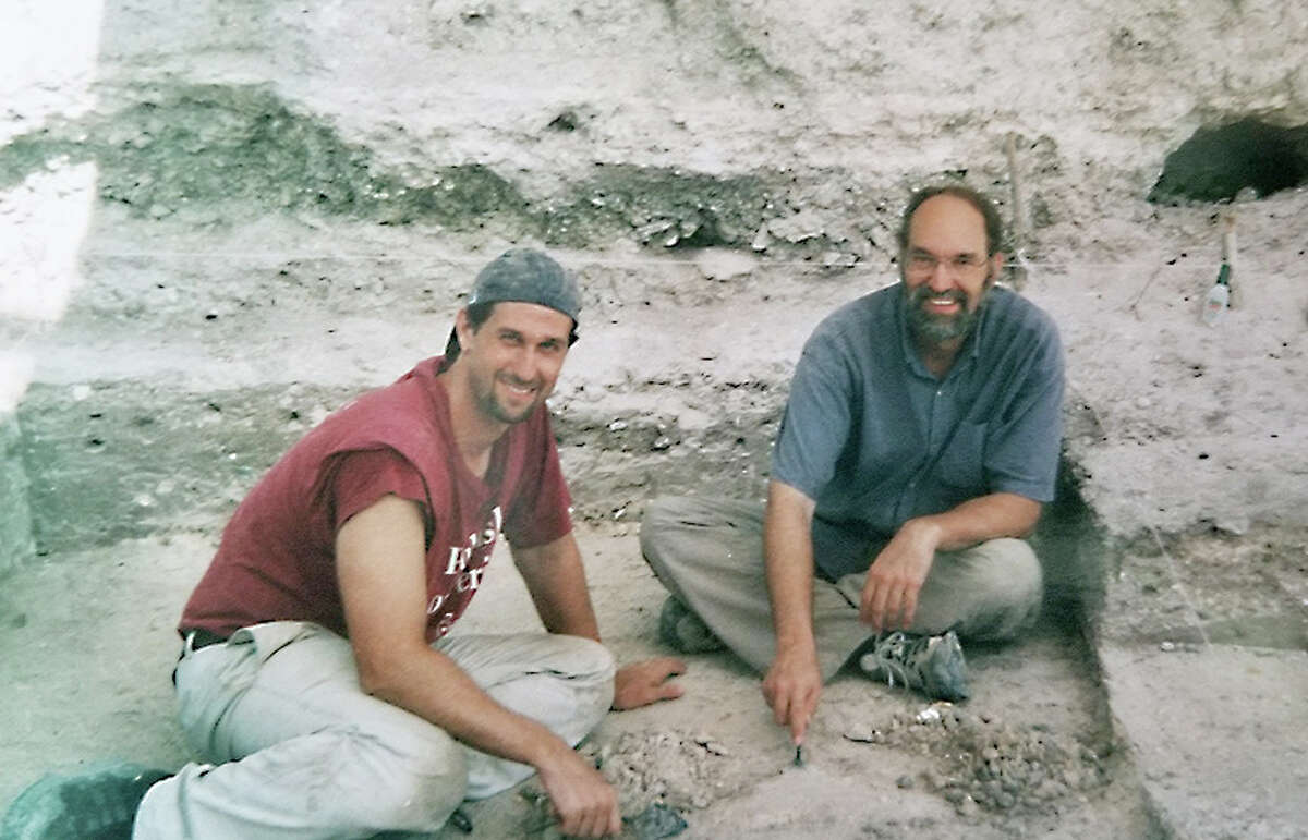 At left, Robert Rosenswig, director of the University at Albany's Institute for Mesoamerican Studies, takes a break at an archeological site in Belize.