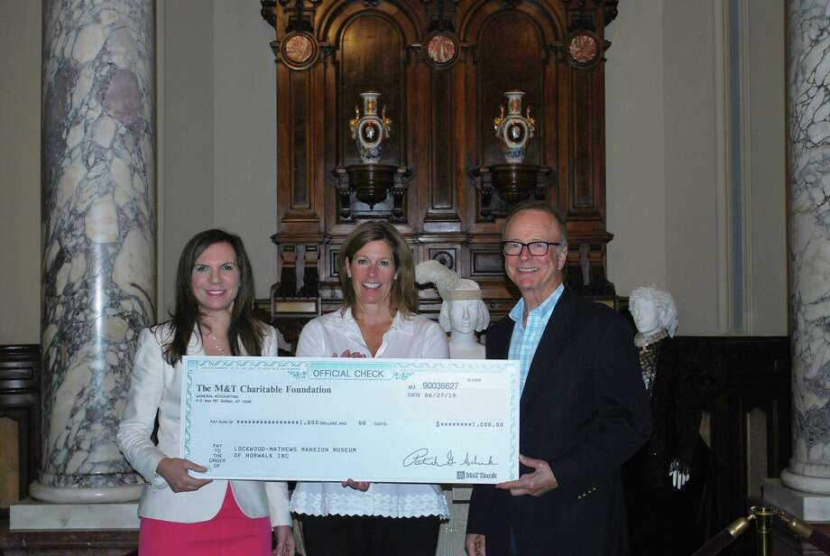 "The Lockwood-Mathews Mansion Museum in Norwalk has received a $1,000 grant from The M&T Bank Charitable Foundation in support of the museum's ""Great Gatsby"" Tea, taking place Nov. 3. Pictured are LMMM Executive Director Susan Gilgore, left, Deborah Olsen Robertson, M&T Bank's Vice President and Senior Commercial Real Estate Lender and Trustee Kim Morque. Photo: Lockwood-Mathews Mansion Museum / Contributed Photo"