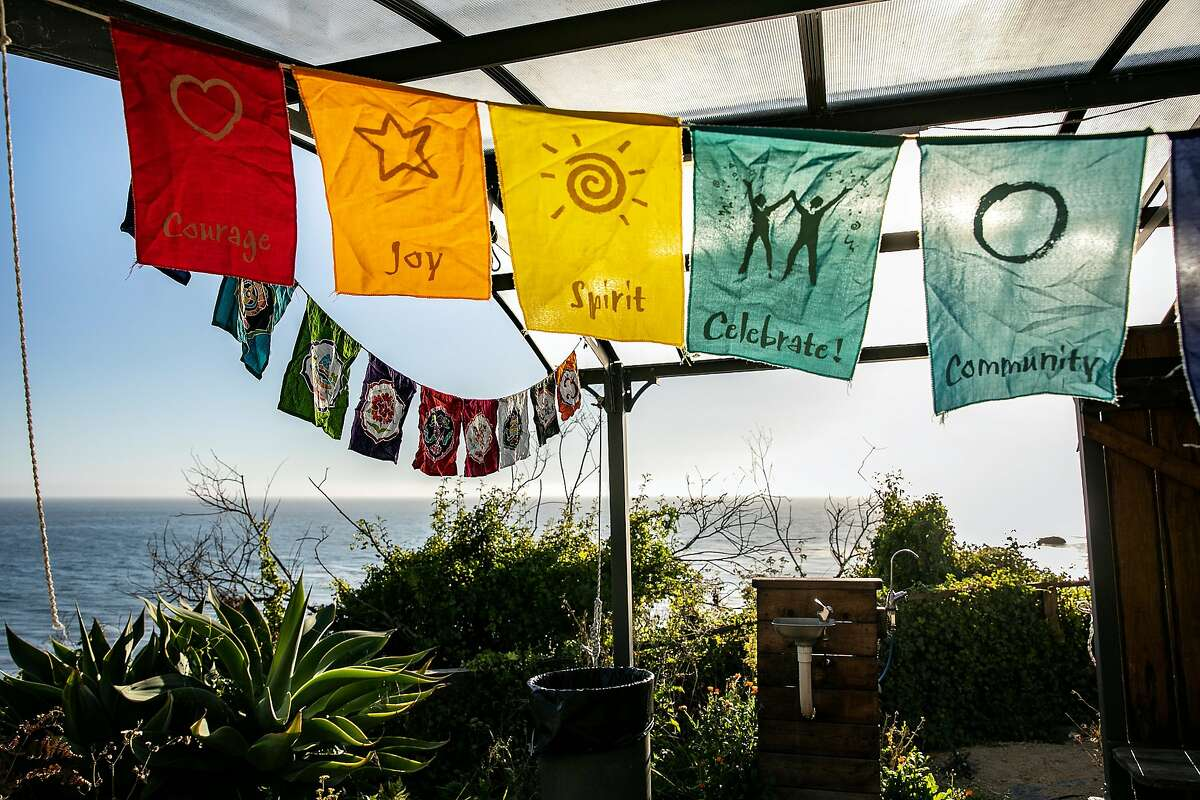 Banners hang outside the Leonard Pavilion meeting room at Esalen on Friday, August 30, 2019 in Big Sur, Calif.