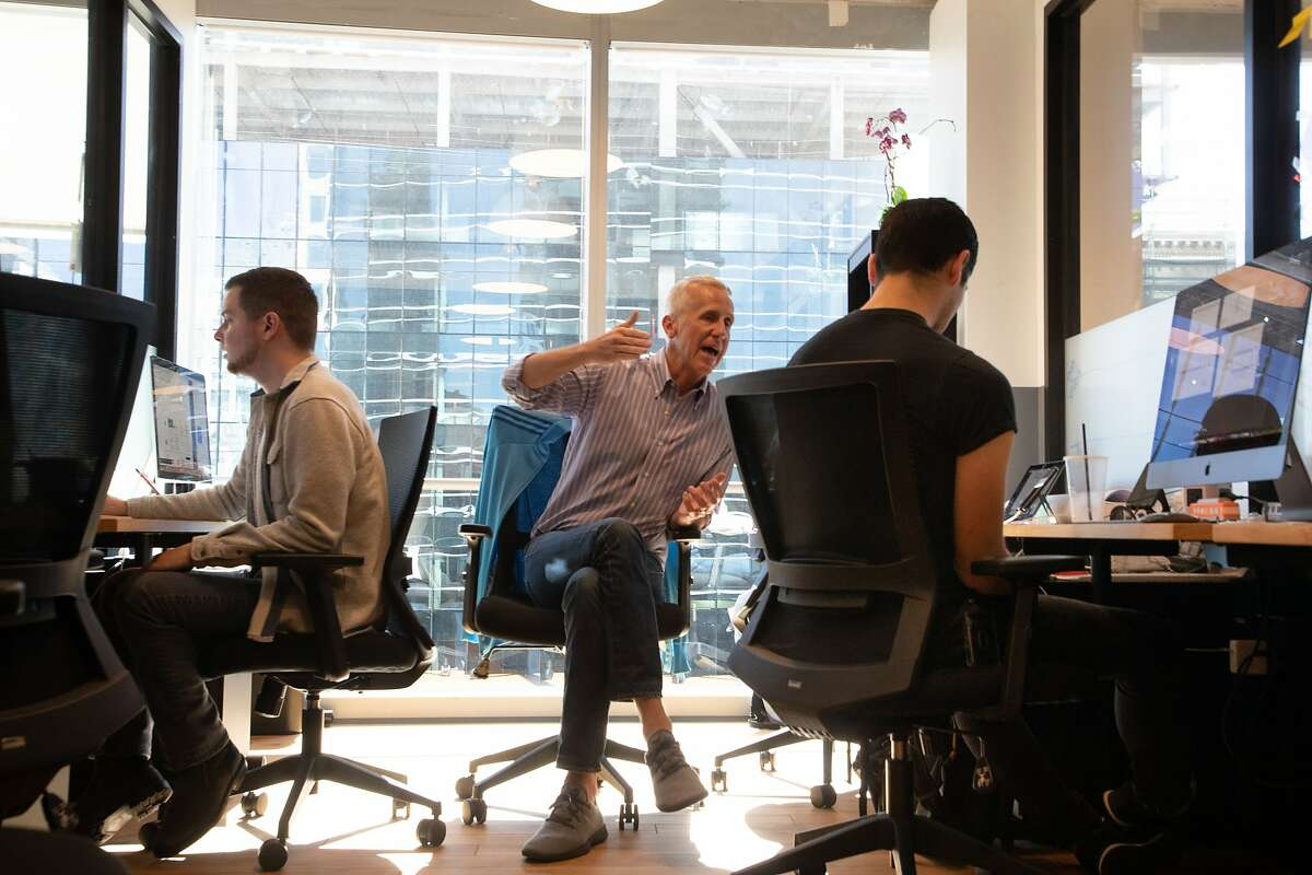 Taylor Huckaby, acting head of Communications, Derek Gordon, Chief Operating Officer, and Moses Maynez working on their online college on at WeWork Wednesday, April 17, 2019, in Oakland, Calif.