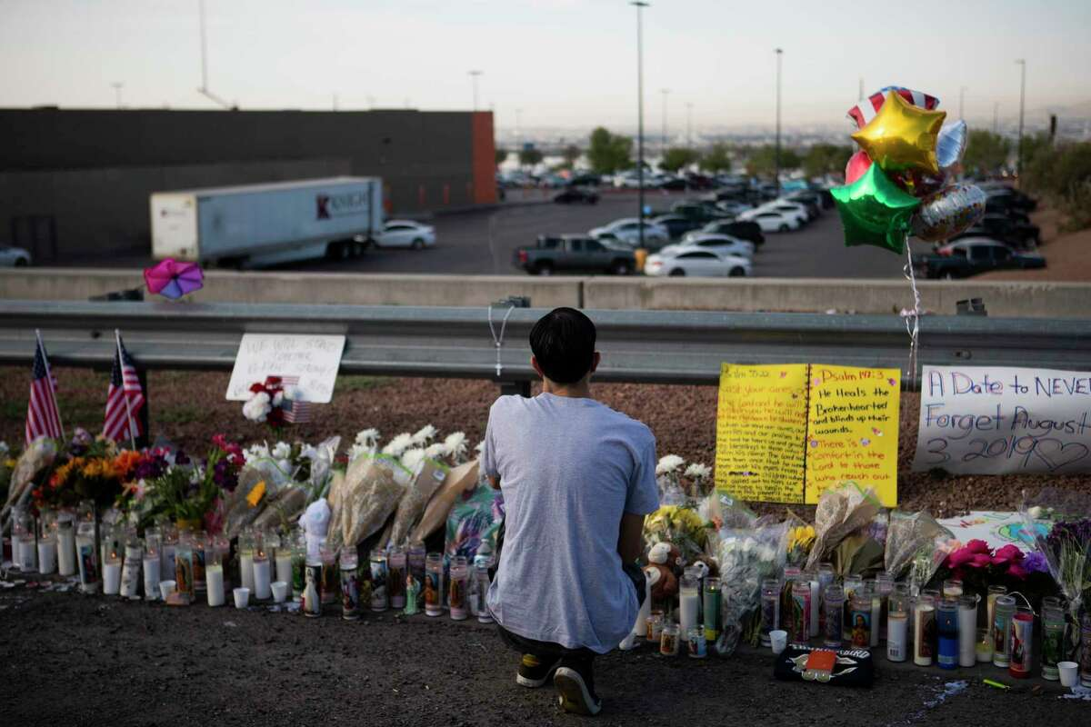 A mourner visits the memorial prepared to honor the victims of the El Pasoshooting at Walmart, Monday, Aug. 5, 2019, in El Paso.