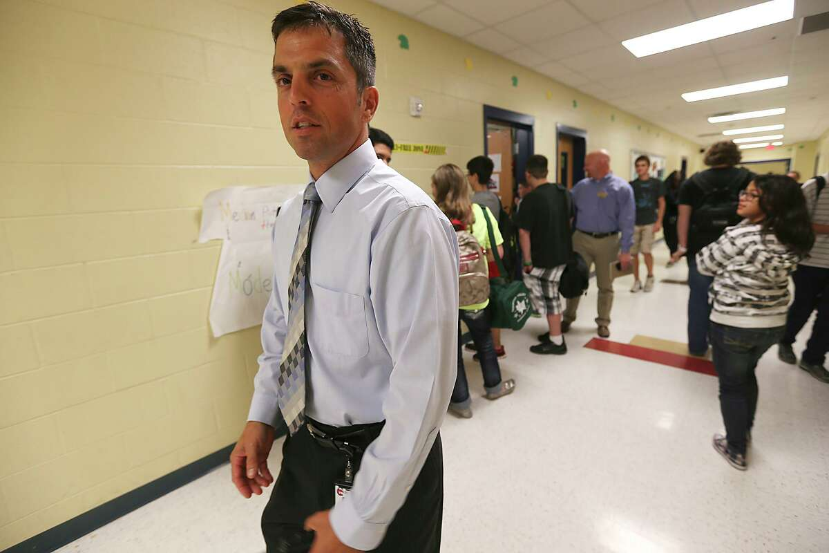 Principal Sean Maika, the future superintendent of North East ISD, walks the halls at Comal ISD's Mountain Valley Middle School in 2013. Today he's planning a budget for NEISD and is worried that the economic damage to the state caused by the coronavirus pandemic will lead to serious funding cuts.