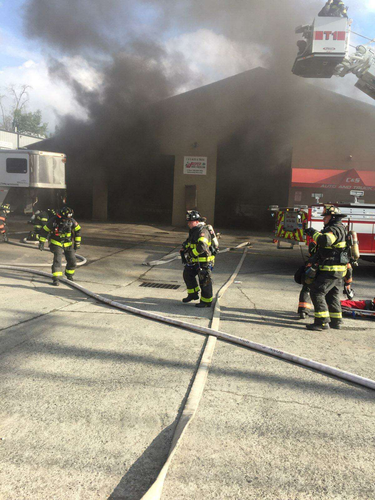 Firefighters work to put out a fire at C & S Auto & Truck Repair in Danbury on Sept. 2, 2019.