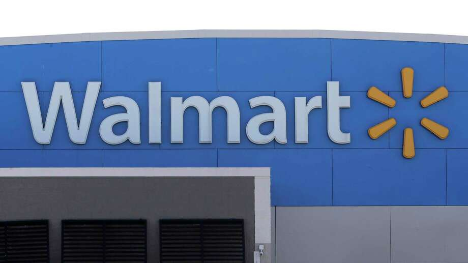 A Walmart logo is attached to the outside of a Walmart store, Tuesday, Sept. 3, 2019, in Walpole, Mass. Walmart is going back to its folksy hunting heritage and getting rid of anything that's not related to a hunting rifle after two mass shootings in its stores in one week left 24 people dead in August of 2019. (AP Photo/Steven Senne) Photo: Steven Senne / Steven Senne/Associated Press / Copyright 2019 The Associated Press. All rights reserved