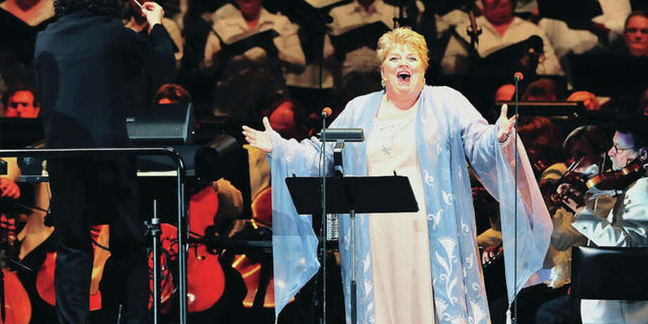 """Gustavo Dudamel conducts soprano Christine Brewer and The Los Angeles Philharmonic in July of 2011, at The Hollywood Bowl in Los Angeles. The Los Angeles Philharmonic performs Puccini's opera, """"Turandot,"""" to benefit the Los Angeles Philharmonic Musicians Pension Fund. Photo: (AP Photo/Katy Winn)"""