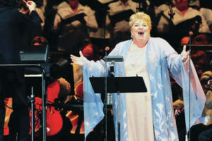 """Gustavo Dudamel conducts soprano Christine Brewer and The Los Angeles Philharmonic in July of 2011, at The Hollywood Bowl in Los Angeles. The Los Angeles Philharmonic performs Puccini's opera, """"Turandot,"""" to benefit the Los Angeles Philharmonic Musicians Pension Fund."""