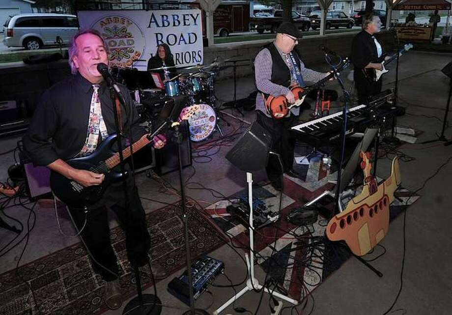 Members of The Beatles tribute band Abby Road Warriors, (left to right) Jack Miller, Dave Sweet, Steve Hoover and Doug Carson, play Saturday at Fireman's Park in Maryville. Abbey Road is the 11th studio album by The Beatles, marking 50 years since its release this month.  Photo: Thomas Turney | For The Intelligencer