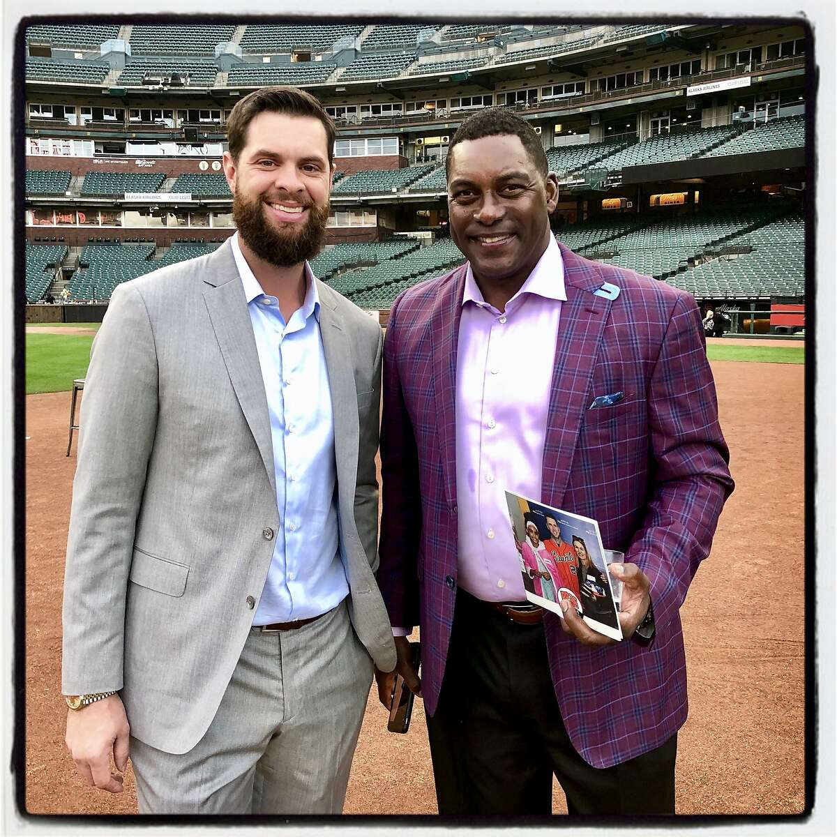 SF Giants first baseman Brandon Belt (left) with Giants bench coach Hensley Meulens at the BP28 Gala. August 28, 2019.