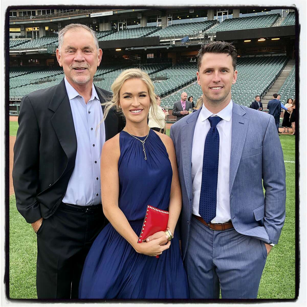 SF Giants Manager Bruce Bochy (left) at Oracle Ballpark with Kristen and Buster Posey for the couple's BP28 Gala. August 28, 2019.