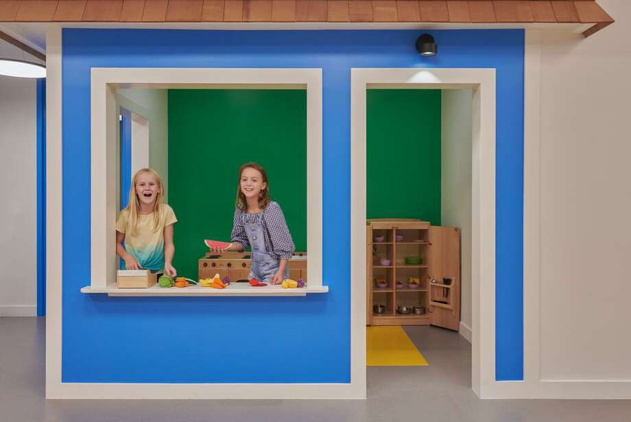 This playhouse, created by Smart Playrooms in Rye, N.Y, was painted green and blue to add energy to the space. Karri Bowen-Poole, owner/designer, recommends decorating playrooms with colors that soothe and relax or excite but that aren't too overwhelming. Photo: Jane Beiles Photography / Connecticut Post
