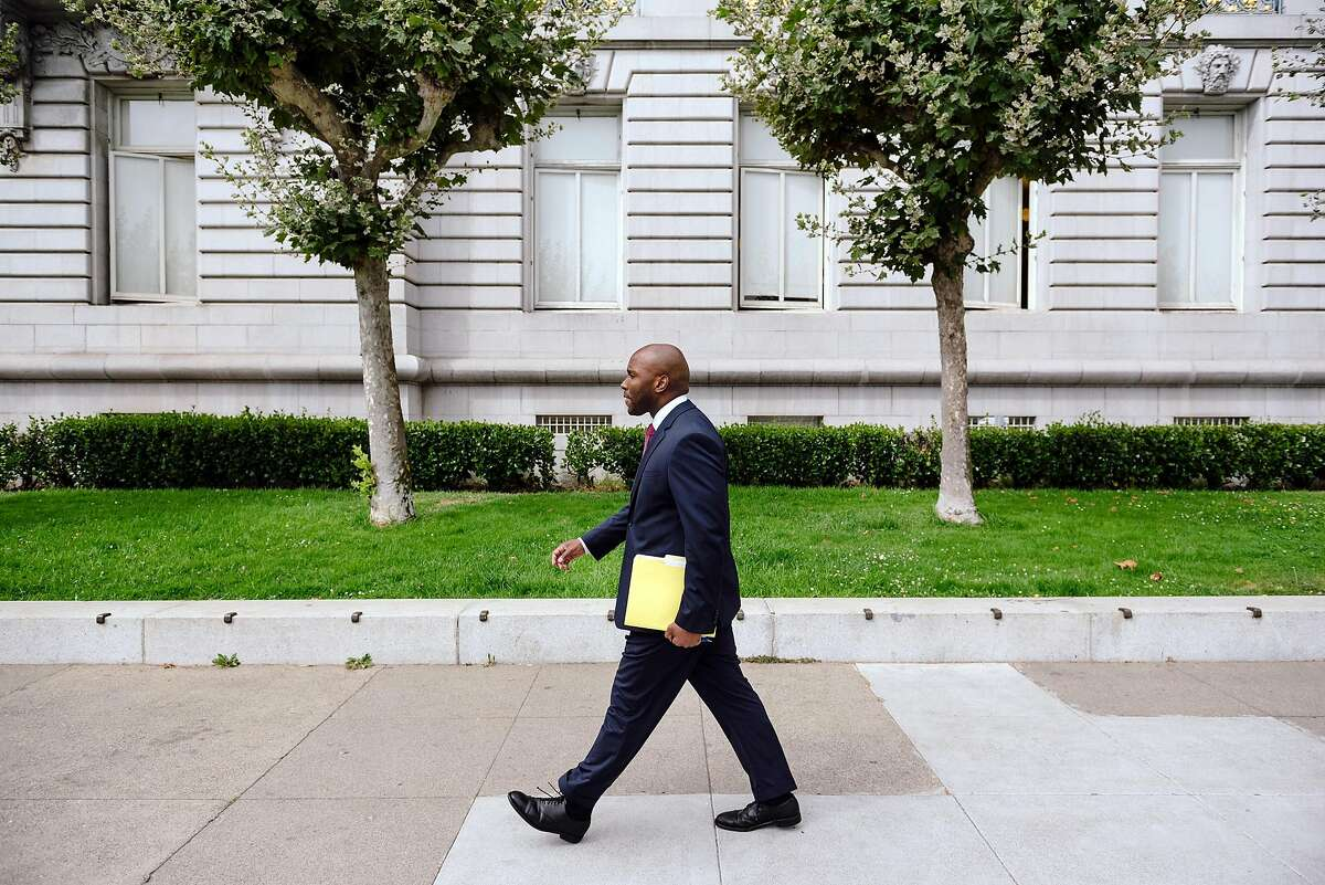 Dr. Anton Nigusse Bland, San Francisco's Director of Mental Health Reform, walks past City Hall in San Francisco, Calif, on Tuesday, September 3, 2019.