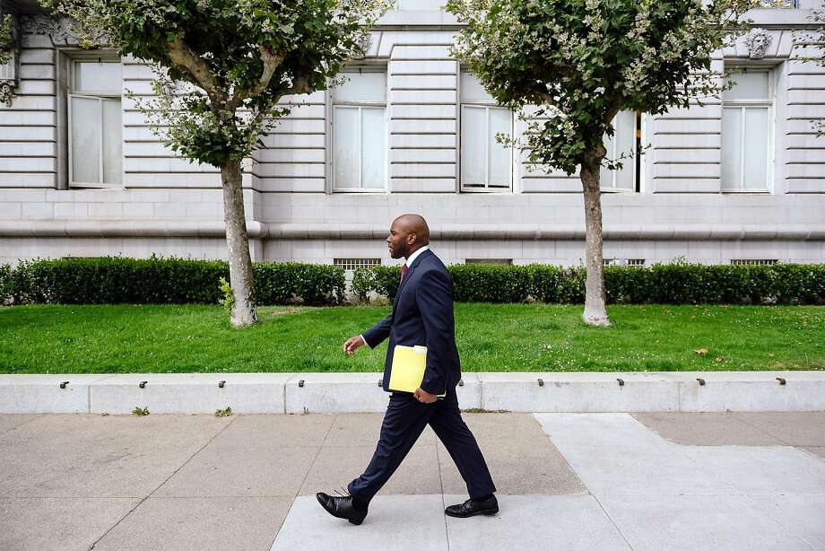 Dr. Anton Nigusse Bland, San Francisco's Director of Mental Health Reform, walks past City Hall in San Francisco, Calif, on Tuesday, September 3, 2019. Photo: Michael Short / Special To The Chronicle