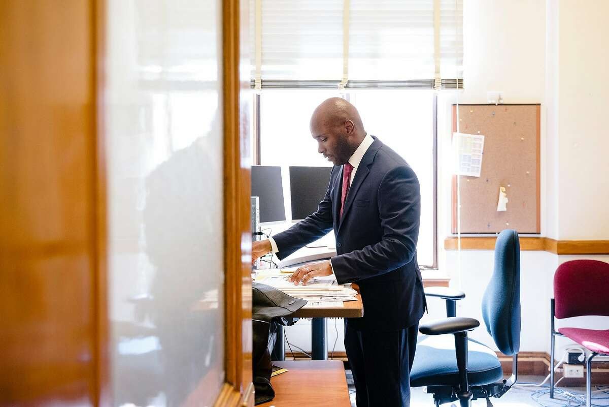 Dr. Anton Nigusse Bland, San Francisco's Director of Mental Health Reform, works in his office inside the Department of Public Health building in San Francisco, Calif, on Tuesday, September 3, 2019.