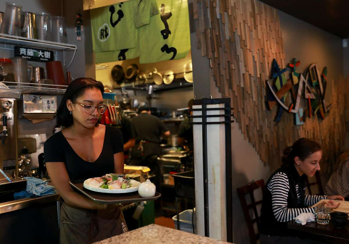 Sakia Hovde prepares to serve food at Kiraku, a Japanese restaurant, located at 2566 Telegraph Ave., in Berkeley, Calif., on Wednesday, August 28, 2019. A court ruling in January 2018 allowed California restaurant owners to implement credit card surcharges for the first time in decades -- but very few Bay Area restaurants have actually begun doing so. Kiraku is one of few restaurants in the Bay Area already implementing a surcharge for credit card users.