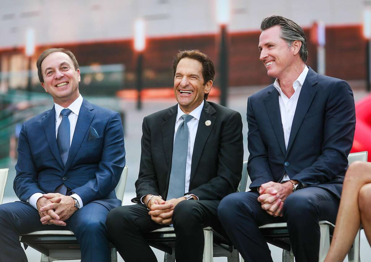 (l-r)Warriors co-owners Joe Lacob, Peter Guber and California Gov. Gavin Newsom joke around during the opening ceremony of the Chase Center in the Mission Bay neighborhood of San Francisco, California, on Tuesday, Sept. 3, 2019.