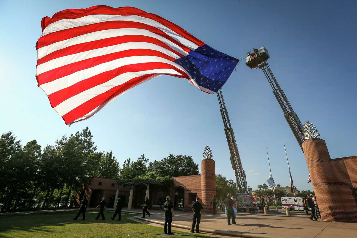 The Patriot Day of Remembrance is scheduled for 7:30-8 a.m. at Central Fire Station, 9951 Grogan's Mill Road. Members of The Woodlands Fire Deparment Honor GUard and others will conduct the Presentation of Colors and do a reading of The Fireman's Prayer as well as the time-honored tradition, The Ringing of the Bell that honors fallen firefighters. The U.S. flag waves from between two fire engines from The Woodlands Fire Department during the First Responders Day ceremony on Monday, Sept. 11, 2017, at Town Green Park.