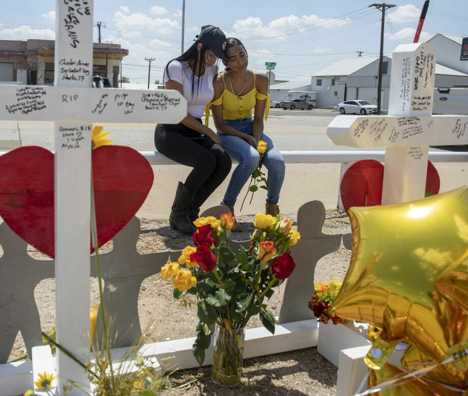 Kimberly Juarez and her mother, Lizeth Aguilar, mourn at white crosses, made by Greg Zanis from Illinois, that were placed on Tuesday, Sept. 3, 2019, at 2nd Street and Sam Houston Avenue in Odessa, Texas. Juarez's best friend, Leilah Hernandez, died in the mass shootings on Saturday, Aug. 31. Photo: Jacy Lewis/Reporter-Telegram