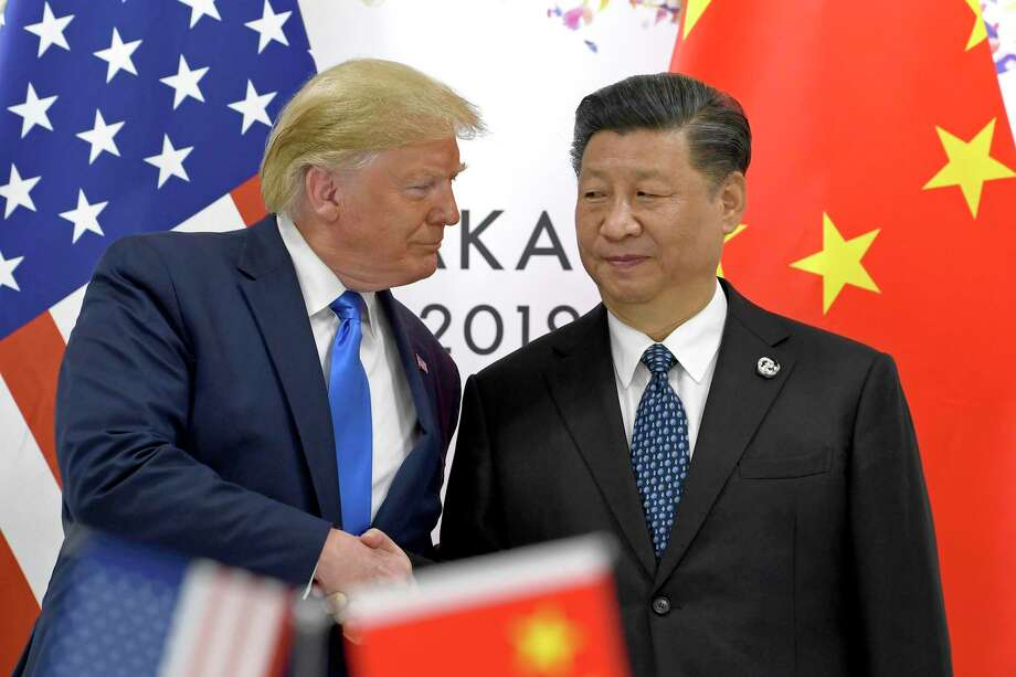 U.S. President Donald Trump shakes hands with Chinese President Xi Jinping during the June G-20 summit in Japan. Trump has said bad management has cost companies, not the ongoing trade war with China. But the trade war has definitely been an economic blow. Photo: Susan Walsh /Associated Press / Copyright 2019 The Associated Press. All rights reserved.