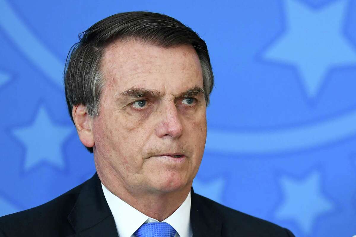 Brazilian President Jair Bolsonaro is pictured during the commemoration ceremony of the National Volunteer Day, at Planalto Palace in Brasilia, on August 28, 2019.