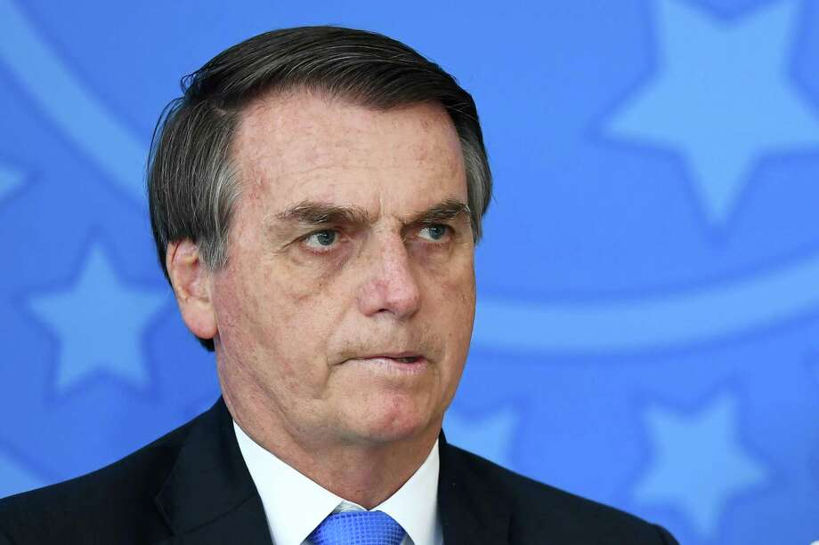 Brazilian President Jair Bolsonaro is pictured during the commemoration ceremony of the National Volunteer Day, at Planalto Palace in Brasilia, on August 28, 2019. Photo: EVARISTO SA, Contributor / AFP/Getty Images / AFP or licensors