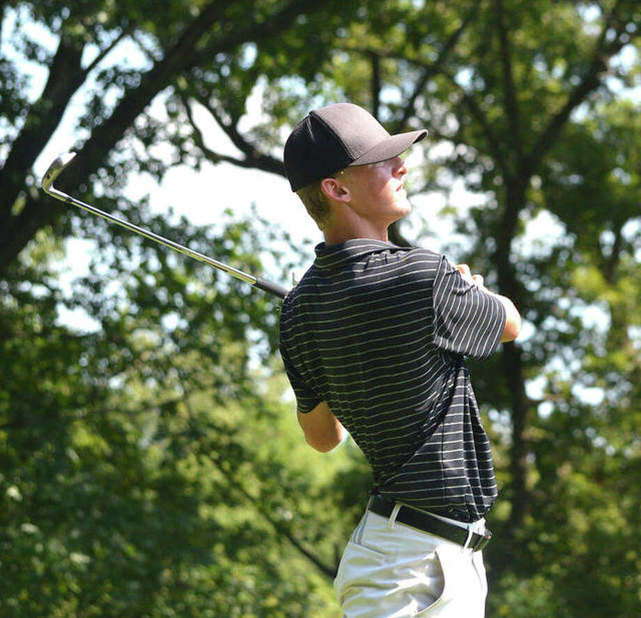 Edwardsville's Hayden Moore watches the flight of his tee shot on Tuesday during the first day of the Southwestern Conference Tournament at Stonewolf Golf Club.