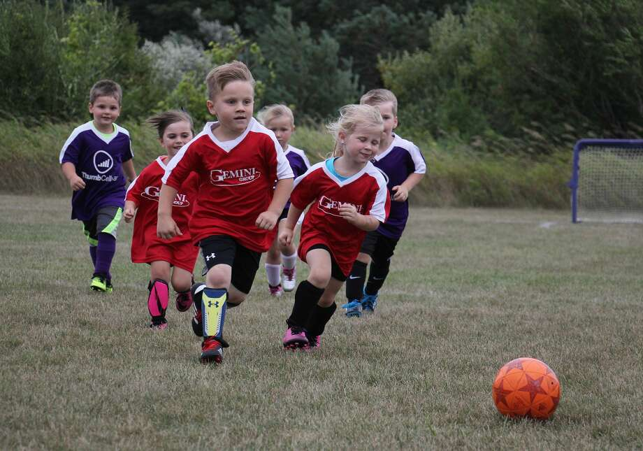 Five-year-old Ethan Talaski, center, chases down the ball Tuesday during opening play of the 2019 Bad Axe Soccer Association season. Talaski scored four goals to give his team, Gemini Group, a victory. Photo: Bradley Massman/Huron Daily Tribune