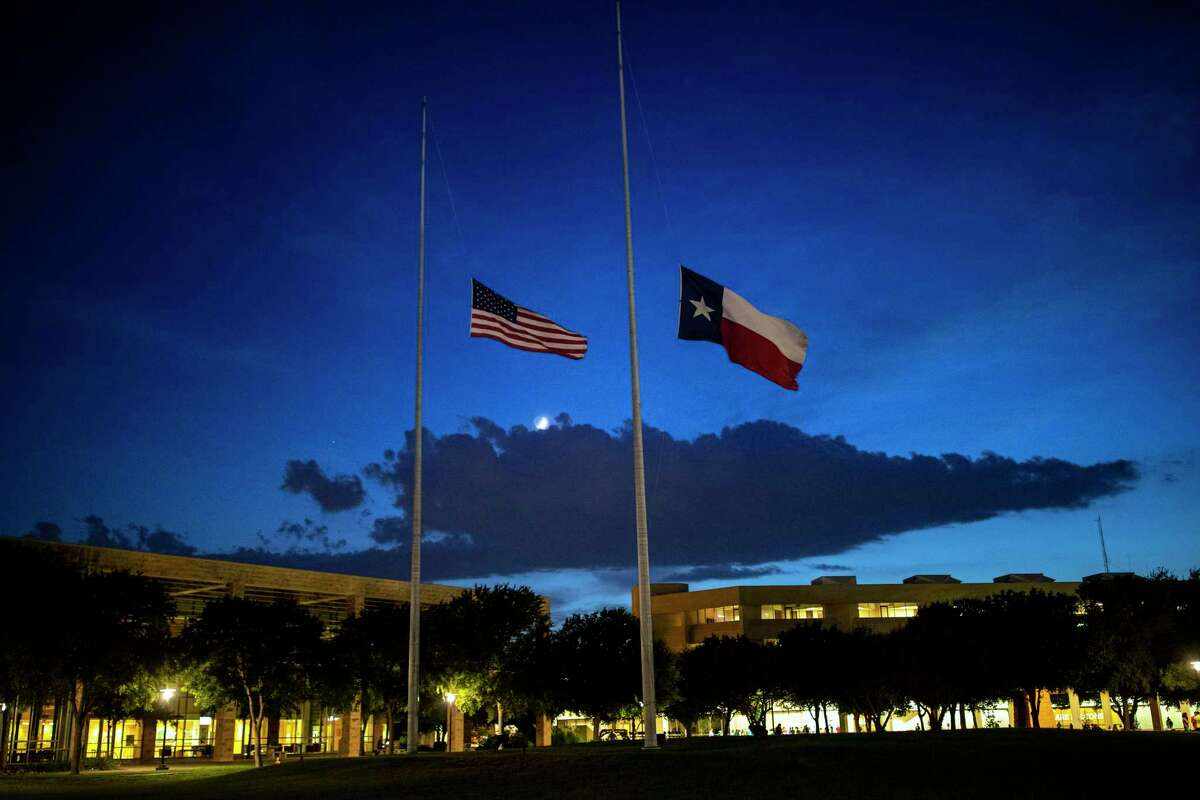 Flags are flown at half-staff after a vigil at the University of Texas Permian Basin for the victims of the mass shooting in Odessa, Texas, Sept. 1, 2019. A city spokesman said seven people had been killed, in addition to the gunman. At least 21 others were wounded, including three law enforcement officers. (Ivan Pierre Aguirre/The New York Times)