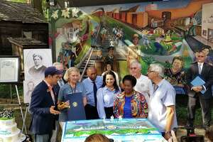 Houston leaders admire the cake donated by Three Brothers Bakery to celebrate Houston's 183rd birthday at The Heritage Society at Sam Houston Park in downtown on Saturday, Aug. 31.
