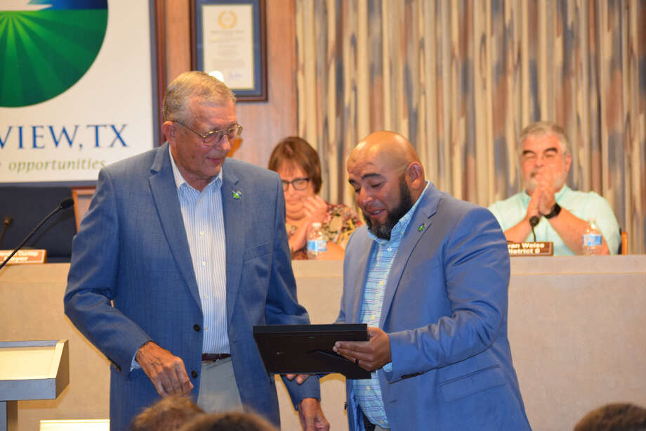 Now-Former City Councilmember Oliver Aldape is recognized during his last City Council meeting as representative of District 7. Mayor Wendell Dunlap presents Aldape with a certificate and thanks him for his service on the council. Photo: Ellysa Harris/Plainview Herald