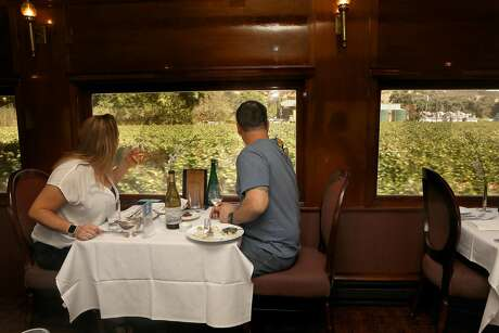 Jessica and James Brooks of Brentwood celebrate their one-year anniversary on the Napa Valley Wine Train. Photo: Liz Hafalia / The Chronicle