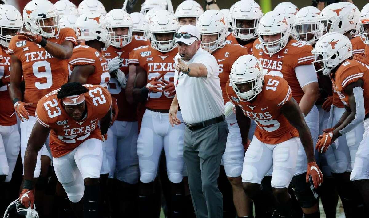 Texas head coach Tom Herman, center, works with his team before an NCAA college football game against Louisiana Tech , Saturday, Aug. 31, 2019, in Austin, Texas. (AP Photo/Eric Gay)