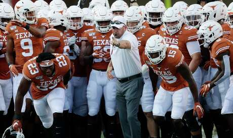 Texas head coach Tom Herman, center, works with his team before an NCAA college football game against Louisiana Tech , Saturday, Aug. 31, 2019, in Austin, Texas. (AP Photo/Eric Gay)
