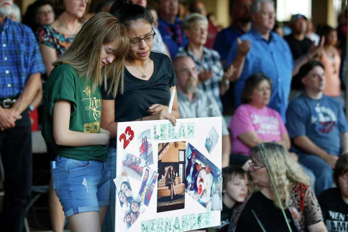 High School students Celeste Lujan, left, and Yasmin Natera, right, mourn their friend, Leilah Hernandez, one of the victims of the Saturday shooting in Odessa, at a memorial service Sunday, Sept. 1, 2019, in Odessa, Texas.