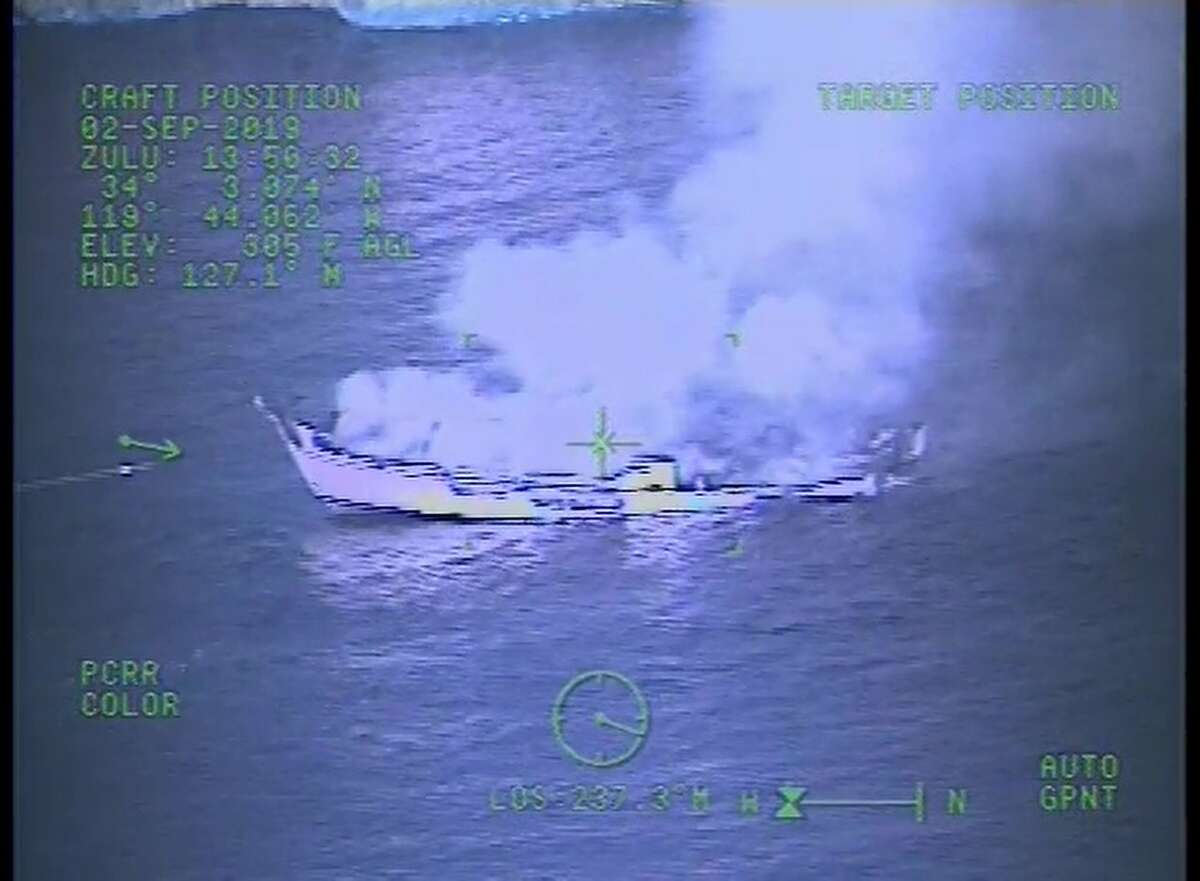 """This Monday, Sept. 2, 2019, image from video released by the U.S. Coast Guard shows a Coast Guard Sector San Diego MH-60 Jayhawk helicopter video screen, as crew responds to the vessel """"Conception"""" boat fire off Santa Cruz Island near Santa Barbara, Calif. Officials say no one likely escaped the flames that tore through a boat packed with scuba divers and the search for survivors has been called off. Authorities said Tuesday that no one has been found alive. Only five of crew members sleeping on the top deck were able to escape early Monday. (U.S. Coast Guard via AP)"""