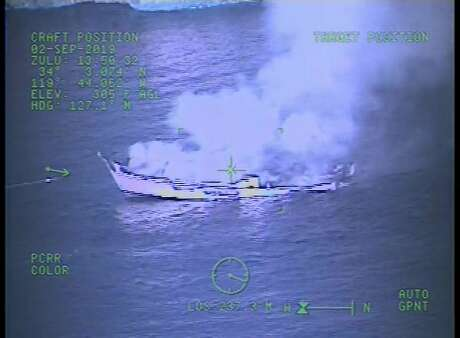 """This Monday, Sept. 2, 2019, image from video released by the U.S. Coast Guard shows a Coast Guard Sector San Diego MH-60 Jayhawk helicopter video screen, as crew responds to the vessel """"Conception"""" boat fire off Santa Cruz Island near Santa Barbara, Calif. Officials say no one likely escaped the flames that tore through a boat packed with scuba divers and the search for survivors has been called off. Authorities said Tuesday that no one has been found alive. Only five of crew members sleeping on the top deck were able to escape early Monday. (U.S. Coast Guard via AP) Photo: Associated Press"""