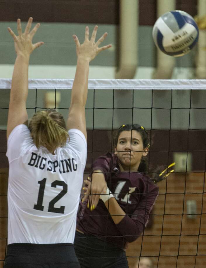 Midland Lee's Yali Flores puts one past the arms of Big Spring's Kalyn Whitehead 09/03/19 at Lee High gym. Tim Fischer/Reporter-Telegram Photo: Tim Fischer/Midland Reporter-Telegram