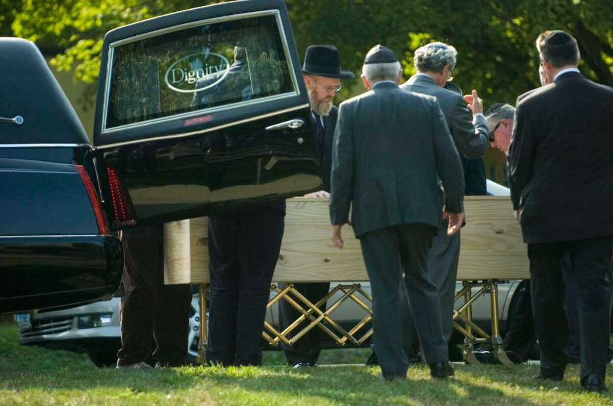 Friends and family attend the funeral for Manchester shooting victim Louis Felder, 50, of Stamford, at Congregation Agudath Sholom in Stamford, Conn. on Wednesday, August 4, 2010.