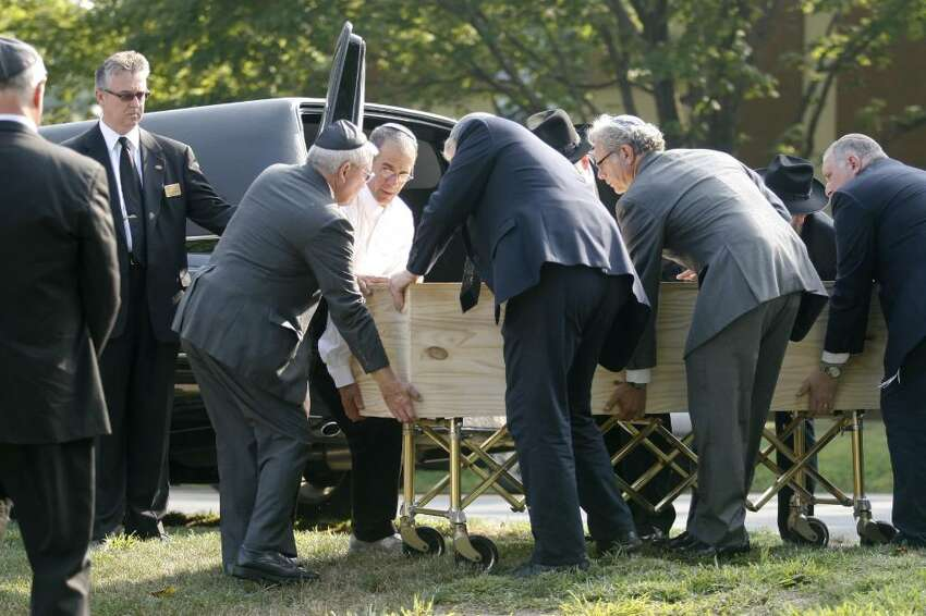 Pallbearers transport the casket of Manchester shooting victim Louis Felder, 50, of Stamford, at Congregation Agudath Sholom in Stamford, Conn. on Wednesday, August 4, 2010.