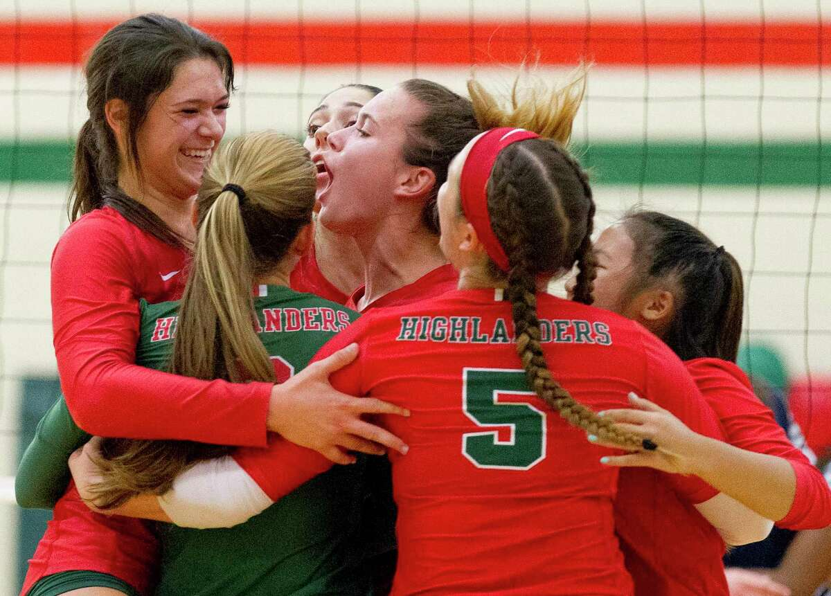 The Woodlands outside hitter Dylan Maberry, far left, reacts with teammates after making a block during the first set of a District 15-6A high school volleyball match at The Woodlands High School, Tuesday, Sept. 3, 2019, in The Woodlands.