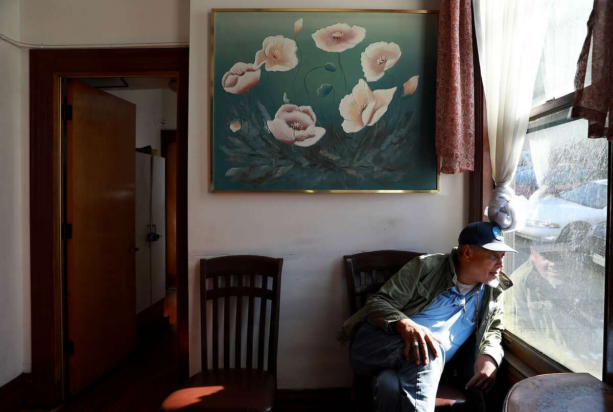 Steven Lax, 70, looks out of a window at a residential care facility, located at 969 Buena Vista West, in San Francisco, Calif., on Tuesday, September 3, 2019.