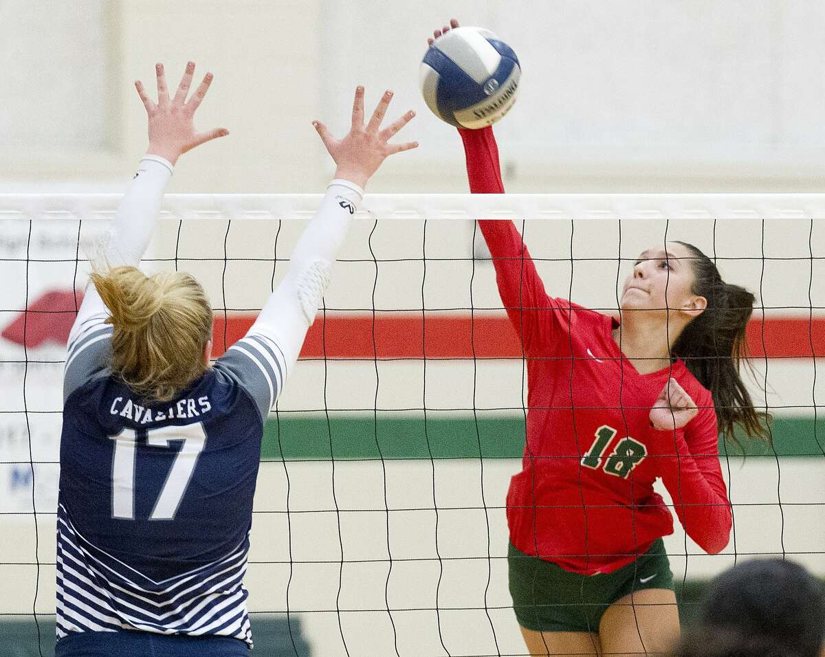 The Woodlands outside hitter Julieta Valdes (18) gets a shot past College Park setter Annie Cooke (17) during the first set of a District 15-6A high school volleyball match at The Woodlands High School, Tuesday, Sept. 3, 2019, in The Woodlands.
