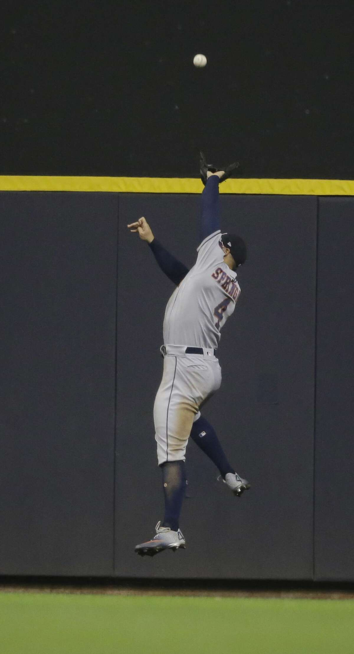 Houston Astros' George Springer makes a leaping catch on a ball hit by Milwaukee Brewers' Ryan Braun during the fifth inning of a baseball game Tuesday, Sept. 3, 2019, in Milwaukee. (AP Photo/Jeffrey Phelps)