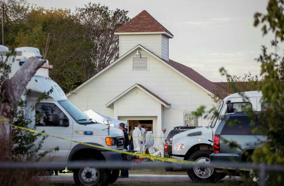 Investigators work at the scene of a deadly shooting at the First Baptist Church in Sutherland Springs, Texas, Sunday Nov. 5, 2017. A man opened fire inside of the church in the small South Texas community on Sunday, killing more than 20 people. (Jay Janner/Austin American-Statesman via AP) Photo: Jay Janner / Jay Janner / Associated Press / Austin American-Statesman