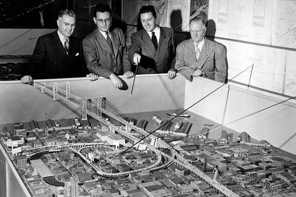 Ralph A. Tudor, chief engineer, H.W. Alexander, Emporium executive, Don Gazackerly and Tom Maloney look at a model of a proposed second Bay Bridge crossing that was never actualized on November 16, 1948.